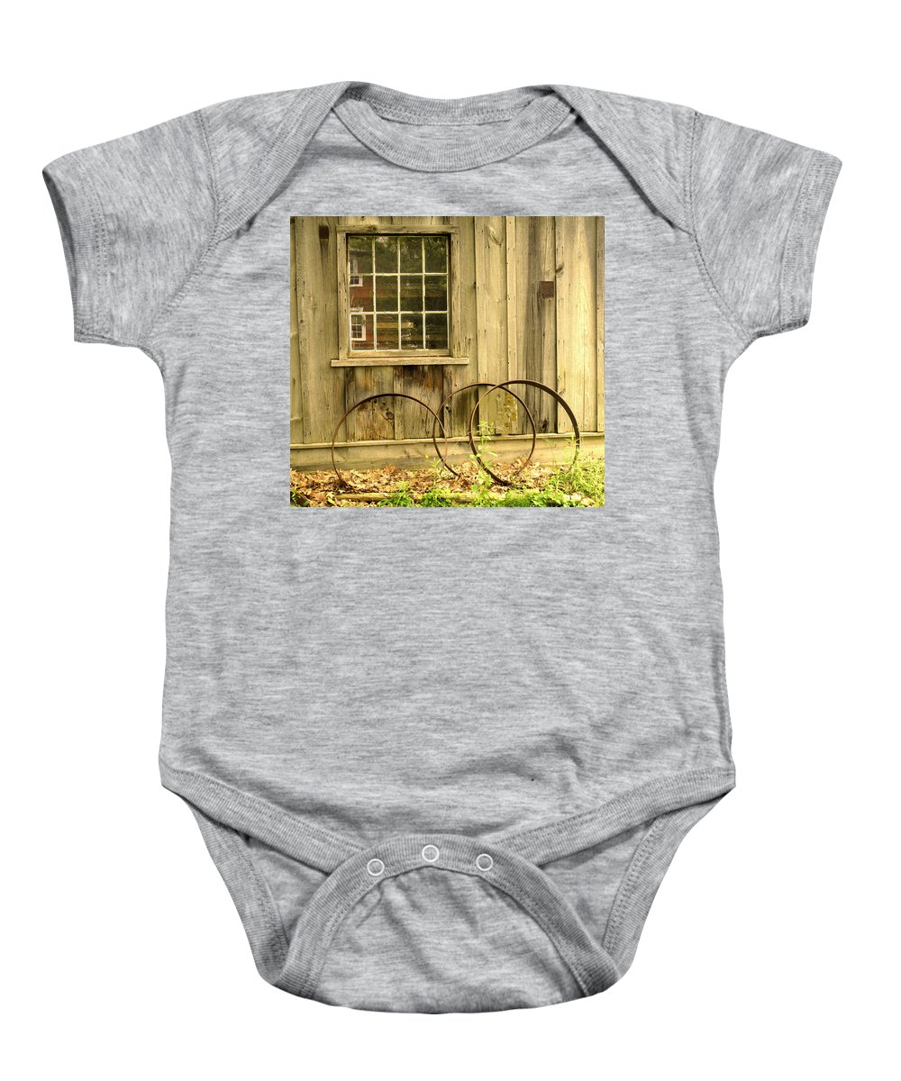 Wheel Rims Baby Onesie featuring the photograph Wheel Rims by Ian MacDonald