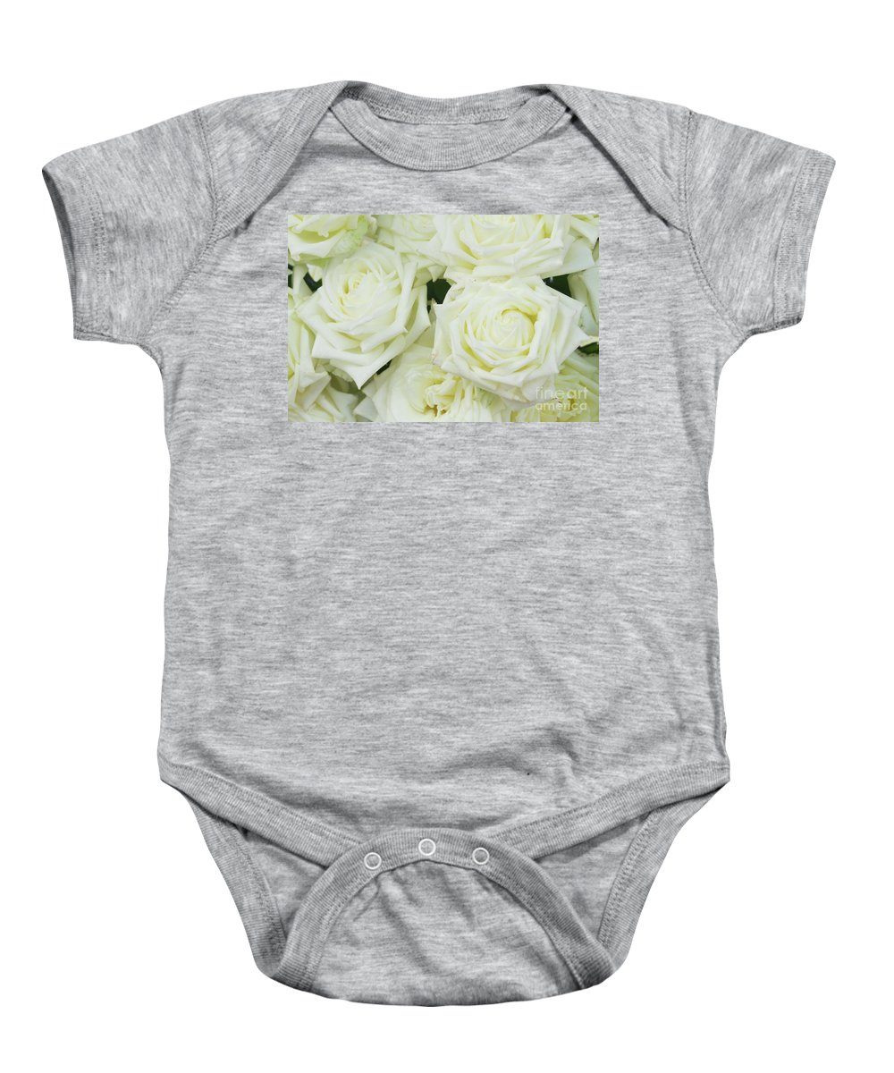 Rose Baby Onesie featuring the photograph White Blooming Roses by Anastasy Yarmolovich