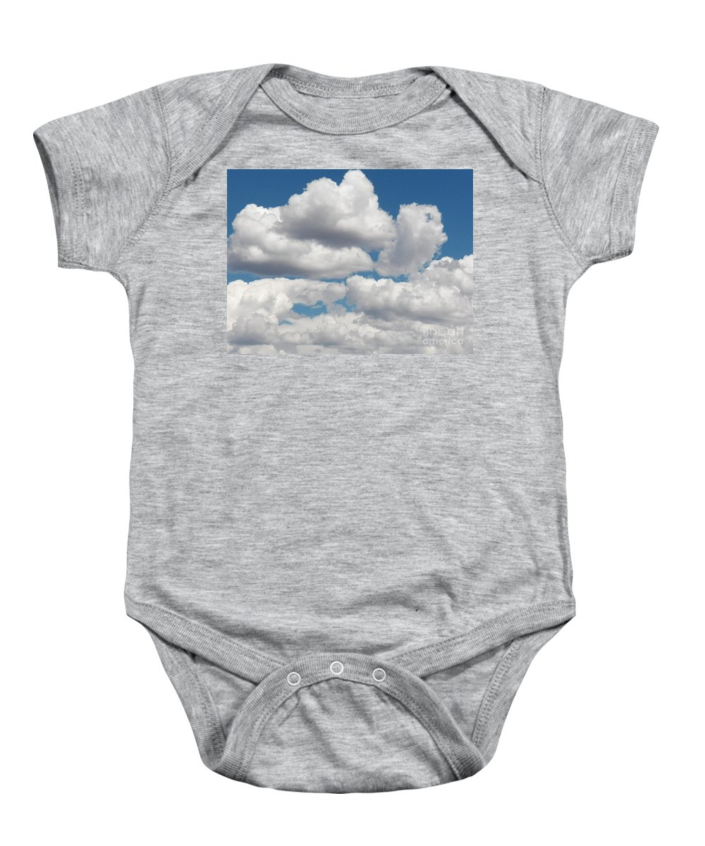 Clouds Baby Onesie featuring the photograph Window Shopping by Brian Commerford