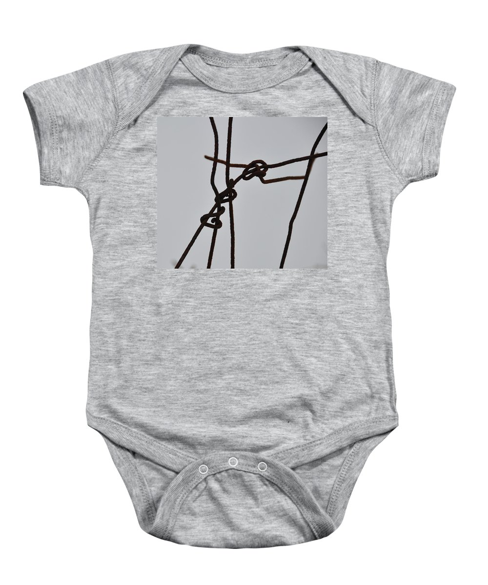 Wire Baby Onesie featuring the photograph Wire And Snow by David Arment