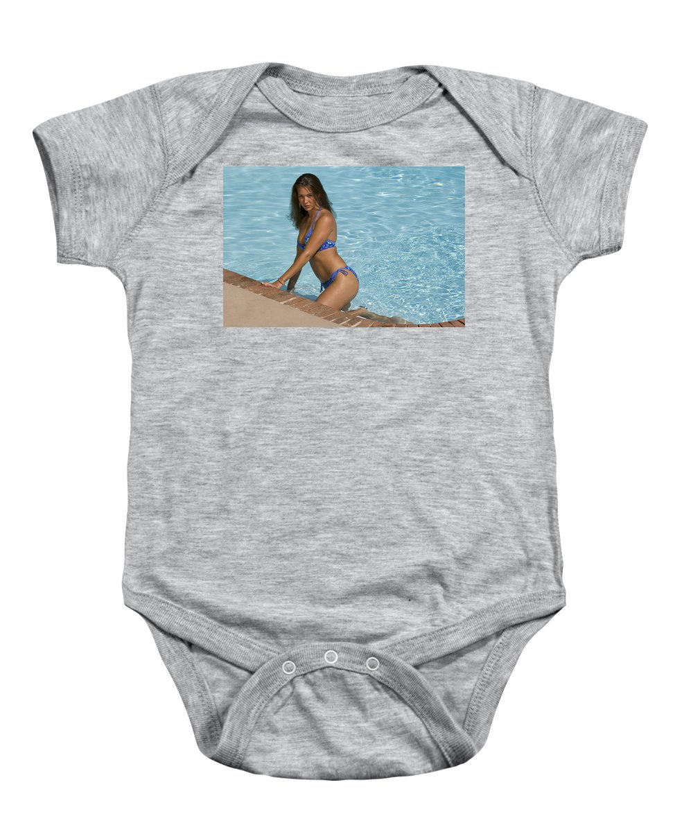 Bikini Baby Onesie featuring the photograph Woman In A Pool. by Robert Ponzoni