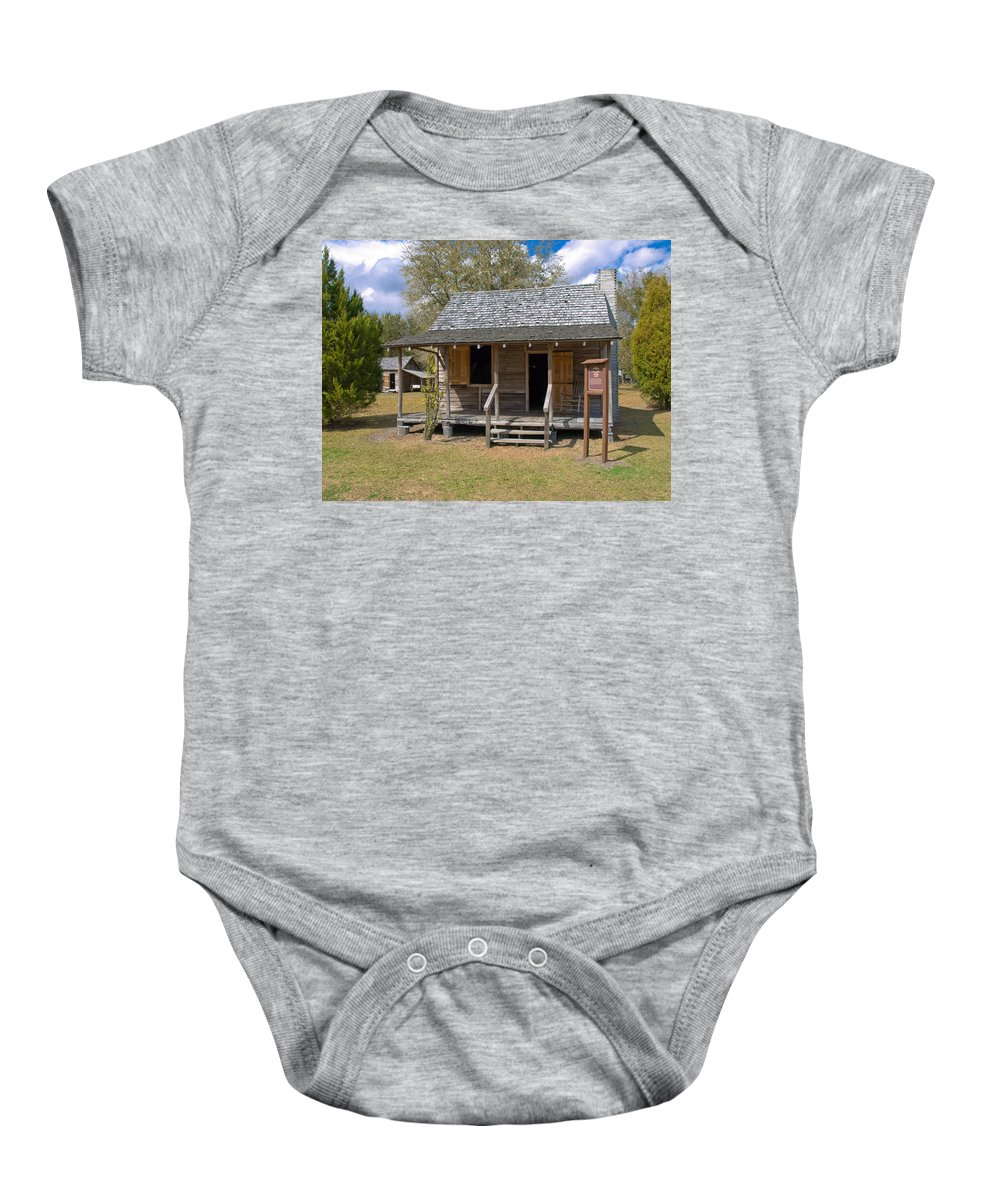 Cabin Baby Onesie featuring the photograph Yates Homestead Built In 1893 On Taylor Creek In Central Florida by Allan Hughes