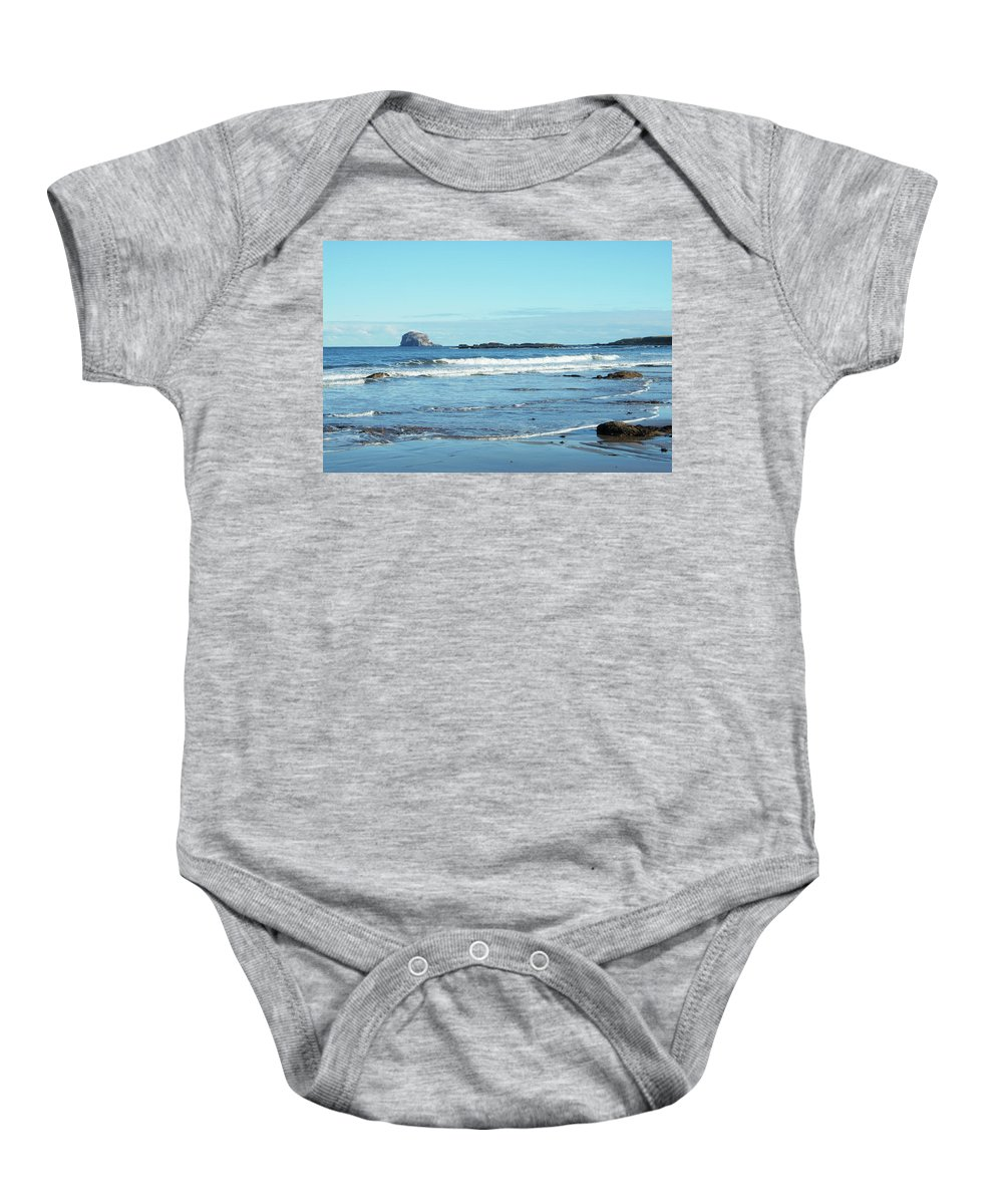 Bass Rock Baby Onesie featuring the photograph Bass Rock And Beach At North Berwick by Victor Lord Denovan