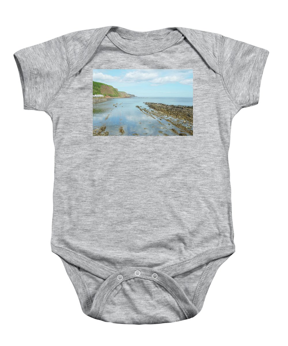 Burnmouth Baby Onesie featuring the photograph Burnmouth Shore, Cliffs And North Sea by Victor Lord Denovan
