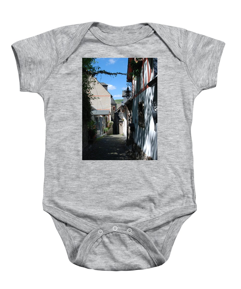 Cobbles Baby Onesie featuring the photograph historic cobbled lane in Beilstein Germany by Victor Lord Denovan