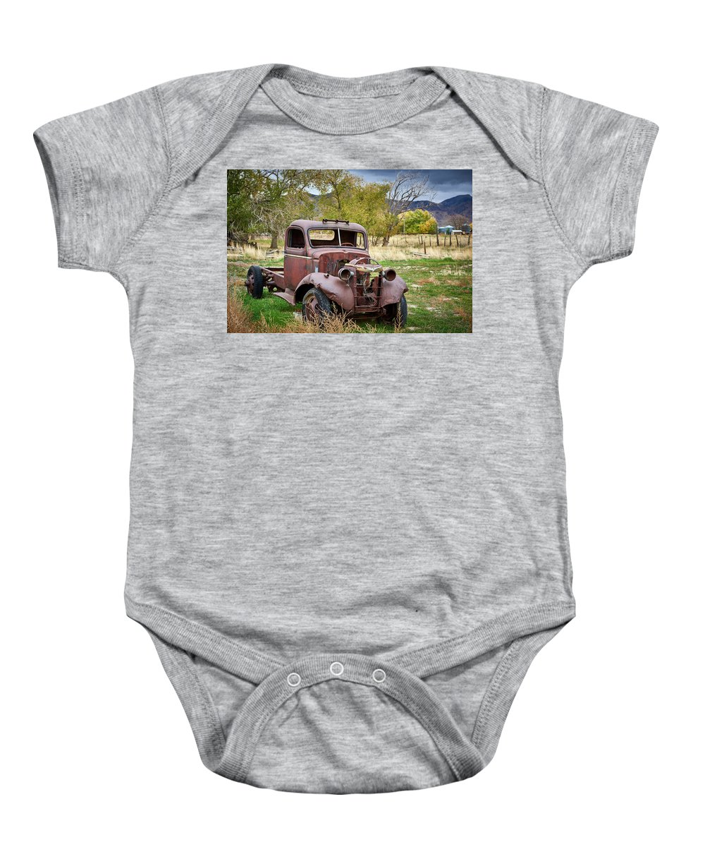 Chevy Baby Onesie featuring the photograph Old Abandoned Chevy Truck by Paul Freidlund