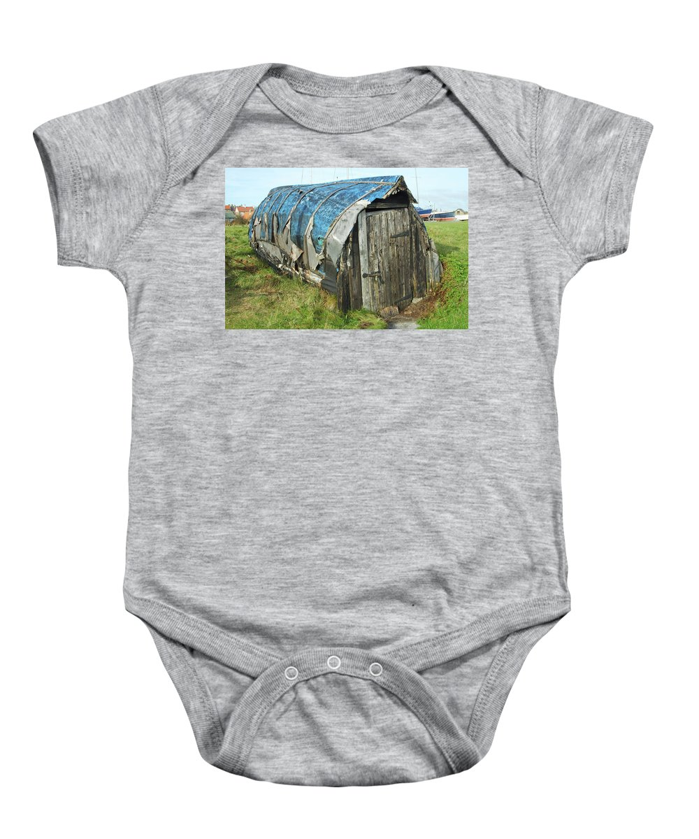 Boat Baby Onesie featuring the photograph old boat hut at Lindisfarne island by Victor Lord Denovan