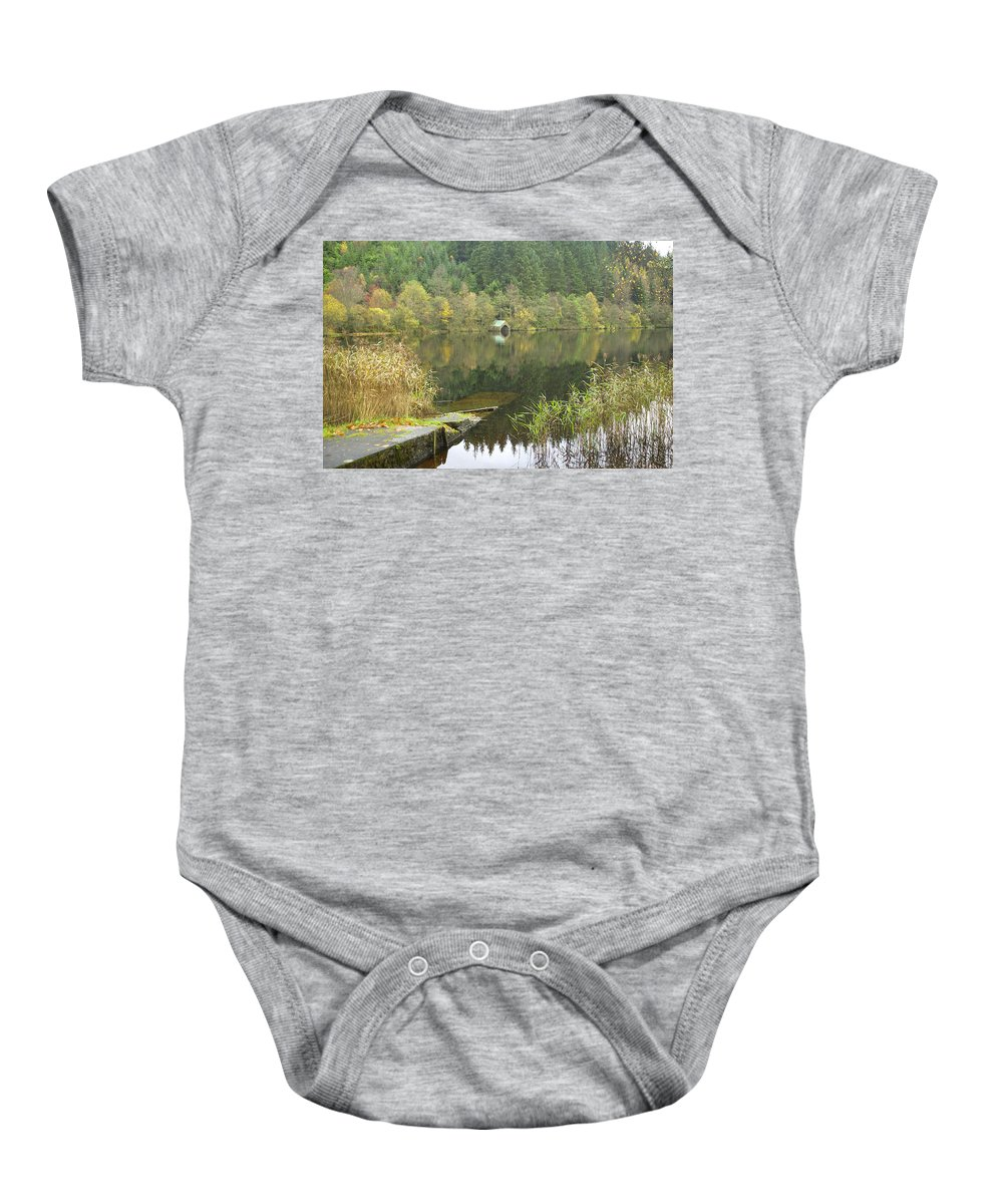 Loch Ard Baby Onesie featuring the photograph old boathouse at Loch Ard near Aberfoyle in autumn by Victor Lord Denovan