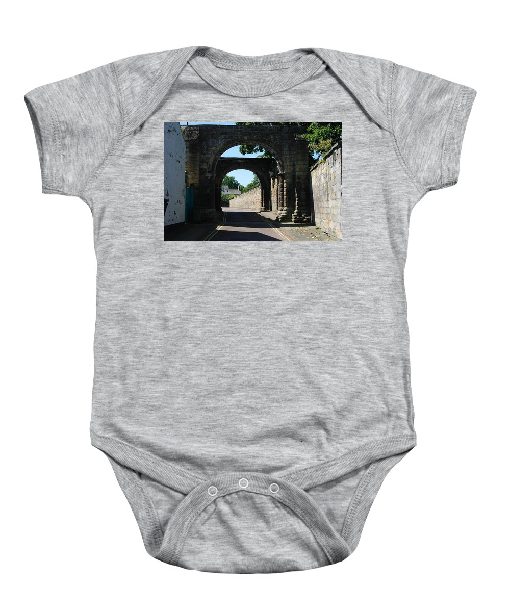 Winding Baby Onesie featuring the photograph old historic town gate in Hexham by Victor Lord Denovan