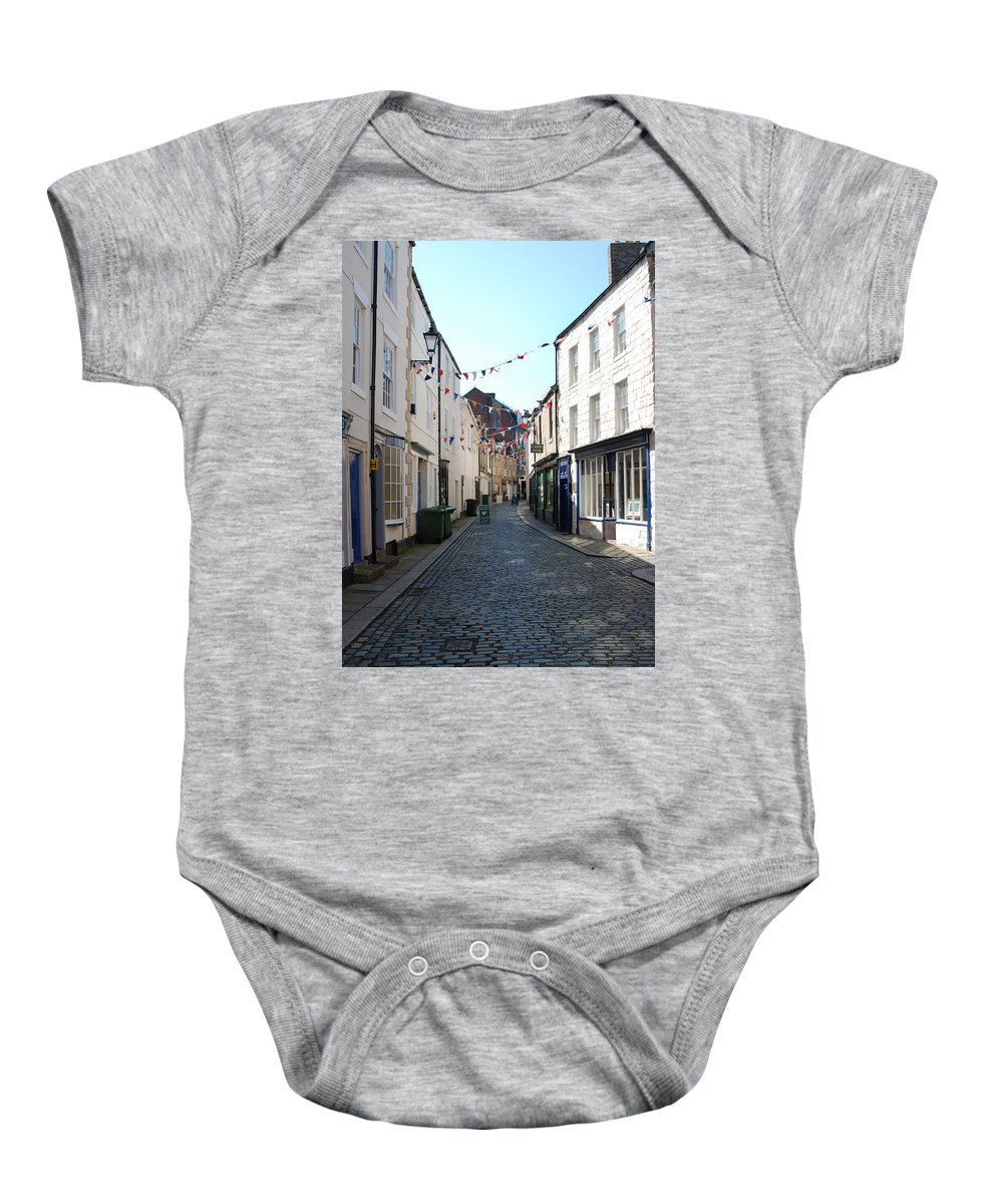 Hexham Baby Onesie featuring the photograph old town street in Hexham by Victor Lord Denovan