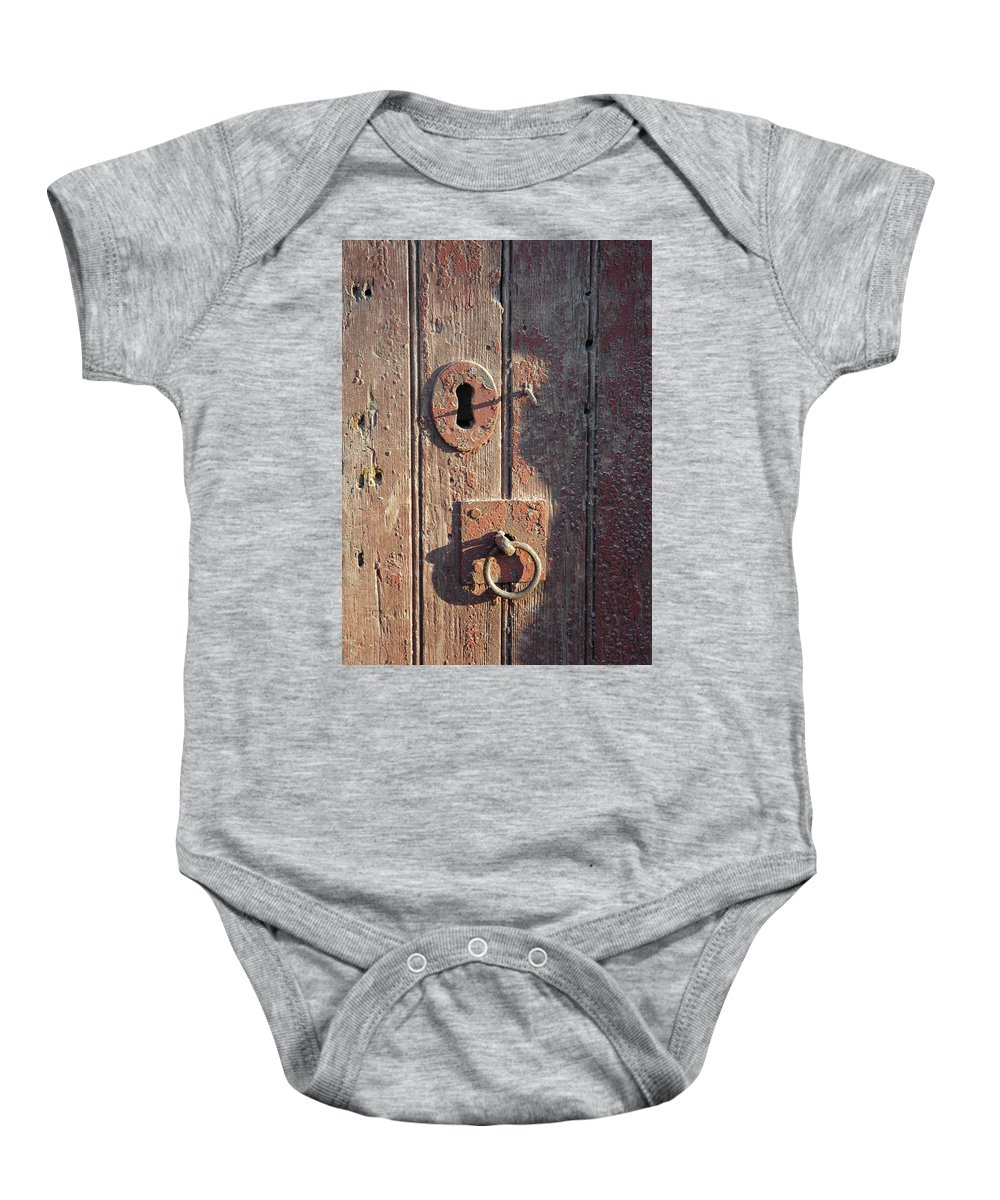 Ring Baby Onesie featuring the photograph Old Wooden Door And Keyhole by Victor Lord Denovan