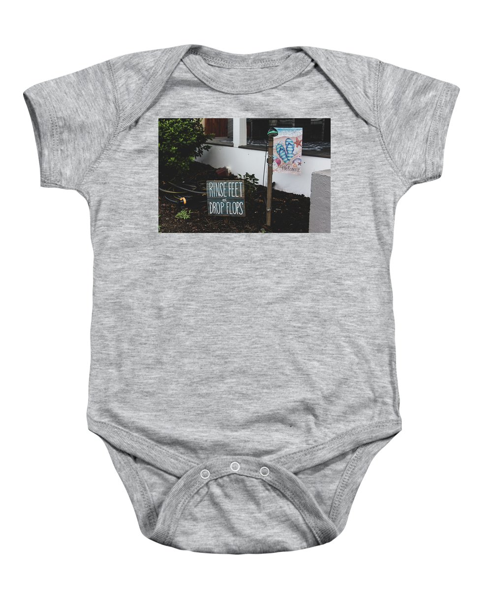 Vacation Baby Onesie featuring the photograph Rinse Feet And Drop Flops by Anthony Doudt
