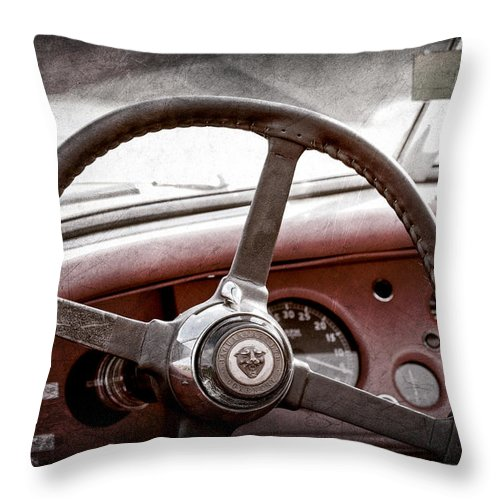 1954 Jaguar Xk120 Roadster Steering Wheel Emblem Throw Pillow featuring the photograph 1954 Jaguar Xk120 Roadster Steering Wheel Emblem by Jill Reger