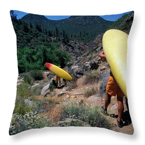 Action Throw Pillow featuring the photograph A Couple Carries Their Kayaks by Corey Rich