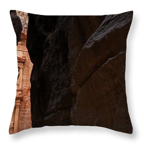 Treasury Throw Pillow featuring the photograph A Glimpse Of Al Khazneh From The Siq In Petra Jordan by Robert Preston