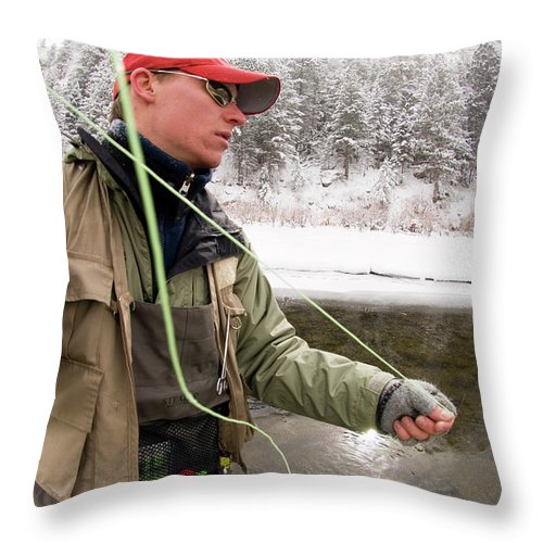 Alone Throw Pillow featuring the photograph A Man Fly Fishing On The Cache La by Tom Bol