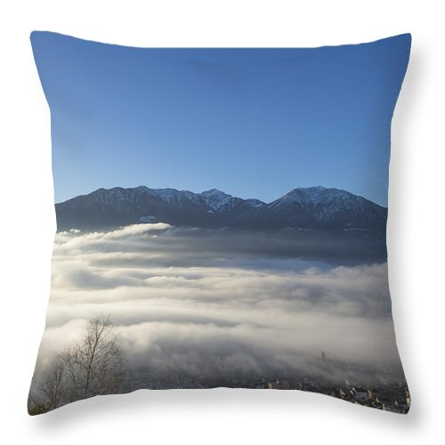Sea Of Fog Throw Pillow featuring the photograph Alpine Village Under Sea Of Fog by Mats Silvan
