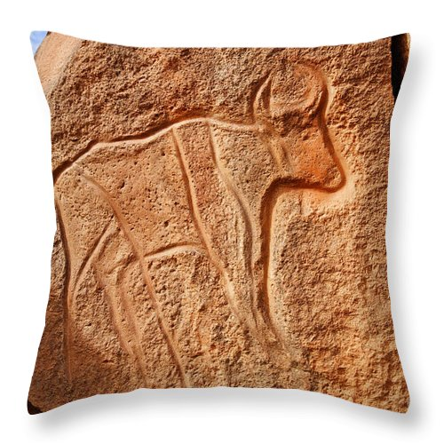 Libya Throw Pillow featuring the photograph Ancient Engraving Of A Buffalo At The Wadi Matkhandouch In Libya by Robert Preston