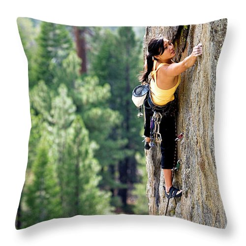 Action Throw Pillow featuring the photograph Attractive Woman Rock Climbing High by Corey Rich
