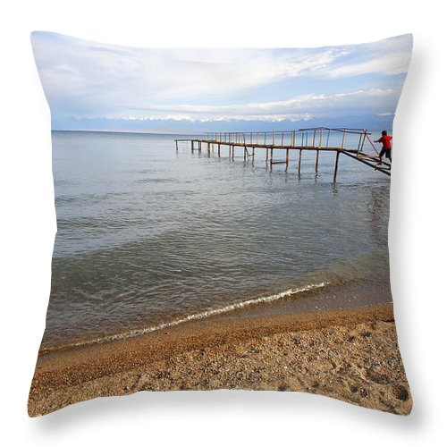 Central Asia Throw Pillow featuring the photograph Broken Pier At Lake Issyk Kul In Kyrgyzstan by Robert Preston