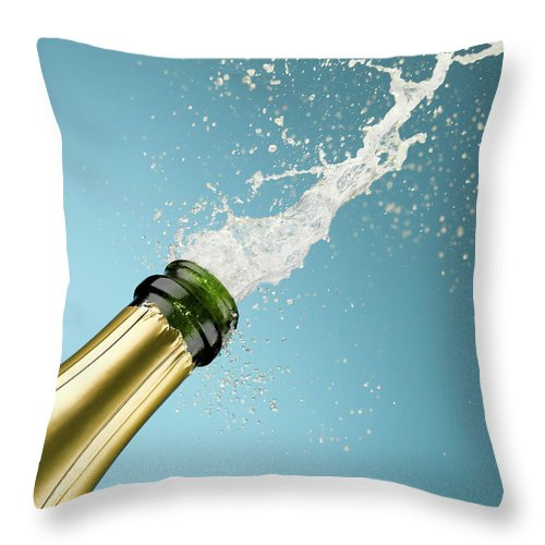 Celebration Throw Pillow featuring the photograph Champagne Exploding From Bottle by Andy Roberts
