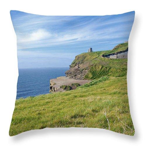 Ireland Throw Pillow featuring the photograph Cliffs Of Moher In Ireland by Birgit Tyrrell