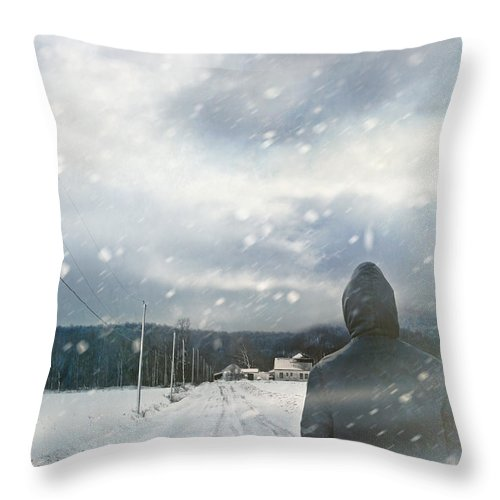 Atmosphere Throw Pillow featuring the photograph Closeup Of Man Walking On Snowy Winter Road by Sandra Cunningham