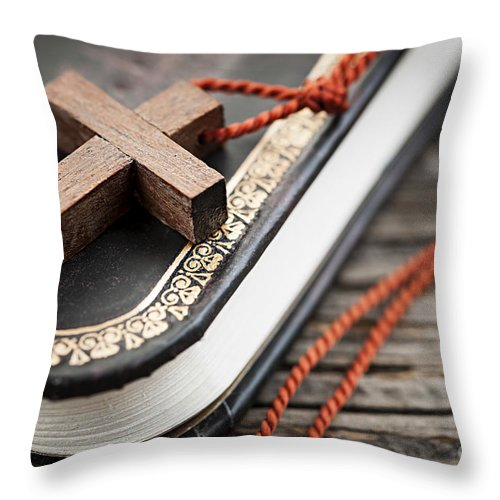 Cross Throw Pillow featuring the photograph Cross On Bible by Elena Elisseeva