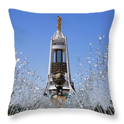 Turkmenistan Throw Pillow featuring the photograph Fountains And The Arch Of Neutrality At Ashgabat In Turkmenistan by Robert Preston