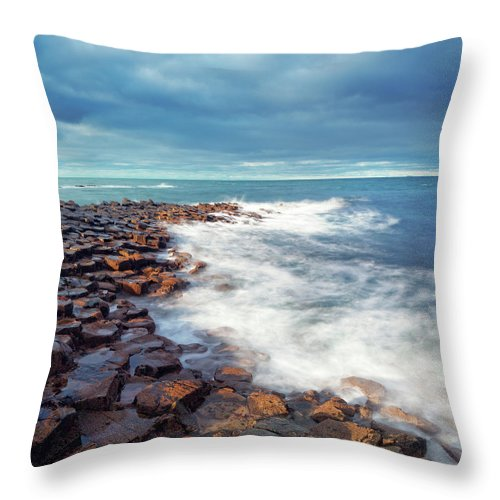 Water's Edge Throw Pillow featuring the photograph Giants Causeway On A Cloudy Day by Mammuth