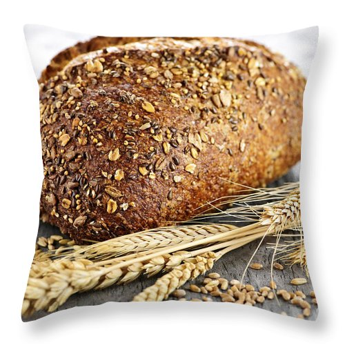 Bread Throw Pillow featuring the photograph Loaf Of Multigrain Bread by Elena Elisseeva
