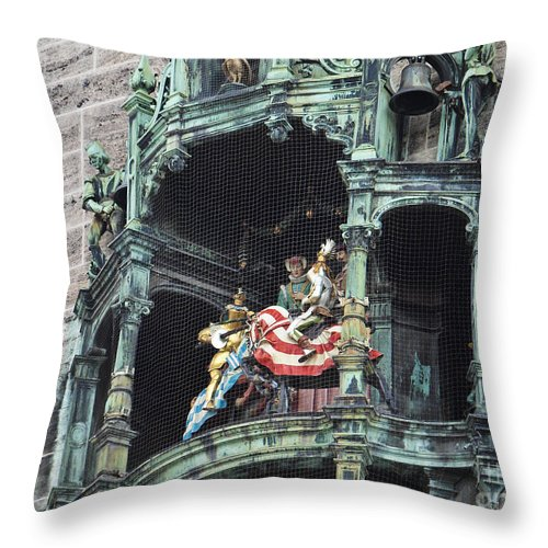 Glockenspiel Throw Pillow featuring the photograph Mechanical Clock In Munich Germany by Howard Stapleton