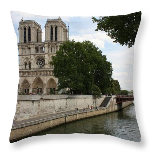 Paris Throw Pillow featuring the photograph Notre Dame Along The Seine by Carol Groenen
