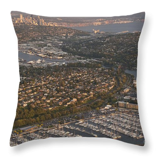Discovery Park Throw Pillow featuring the photograph Seattle Skyline With Shilshole Marina Along The Puget Sound by Jim Corwin