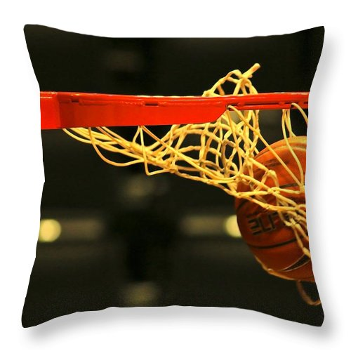 Brown Throw Pillow featuring the photograph Swish by Laddie Halupa