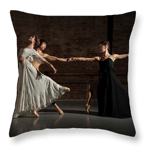 Young Men Throw Pillow featuring the photograph Three Ballet Dancers Performing Together by Nisian Hughes