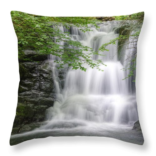 Waterfall Throw Pillow featuring the photograph Stunning Waterfall Flowing Over Rocks Through Lush Green Forest by Matthew Gibson