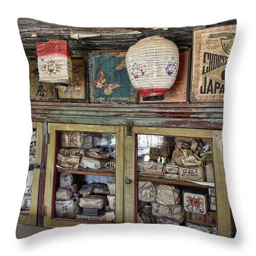Chinese Throw Pillow featuring the photograph 1860's Chinese Mercantile Shop - Montana by Daniel Hagerman