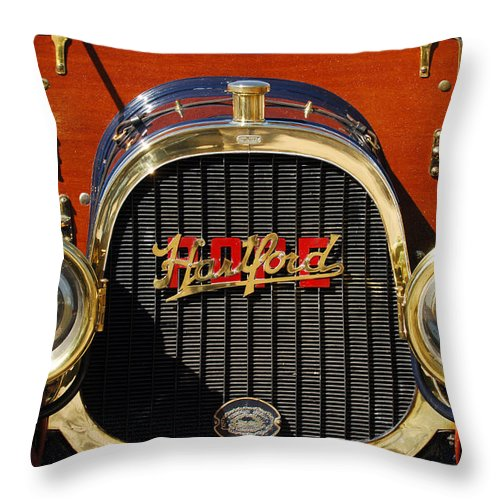 1910 Pope Hartford Model T Grille Emblem Throw Pillow featuring the photograph 1910 Pope Hartford Model T Grille Emblem by Jill Reger