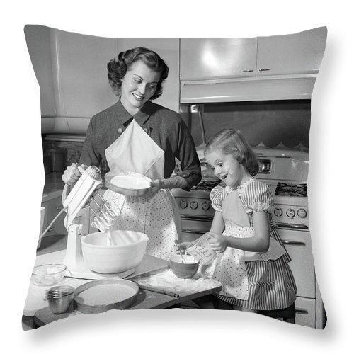 Photography Throw Pillow featuring the photograph 1950s Mother & Daughter Baking A Cake by Vintage Images