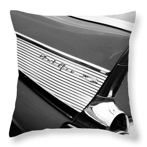 1957 Chevrolet Belair Convertible Taillight Emblem Throw Pillow featuring the photograph 1957 Chevrolet Belair Convertible Taillight Emblem by Jill Reger