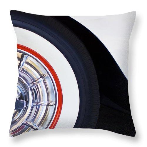 1957 Chevrolet Corvette Convertible Wheel Throw Pillow featuring the photograph 1957 Chevrolet Corvette Wheel by Jill Reger