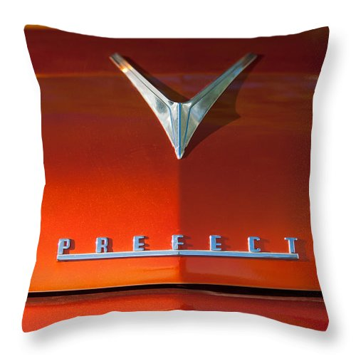 1959 Ford Emblem Throw Pillow featuring the photograph 1959 Ford Prefect Hood Ornament by Jill Reger