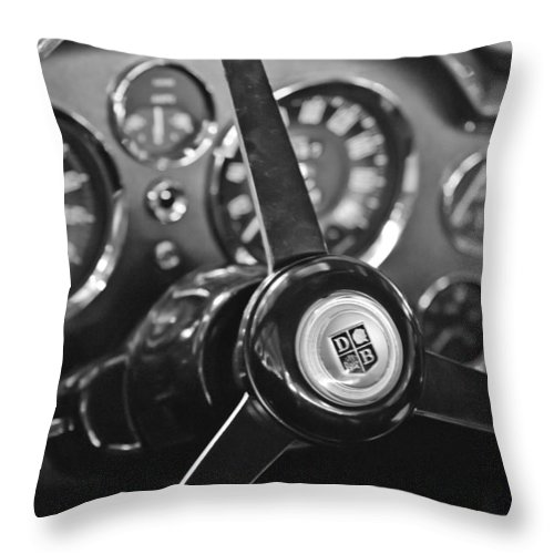 1968 Aston Martin Steering Wheel Emblem Throw Pillow featuring the photograph 1968 Aston Martin Steering Wheel Emblem by Jill Reger