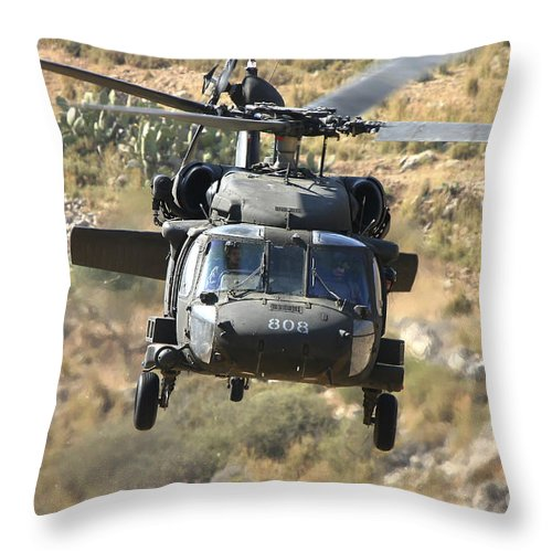 Transportation Throw Pillow featuring the photograph A Uh-60l Yanshuf Helicopter by Ofer Zidon