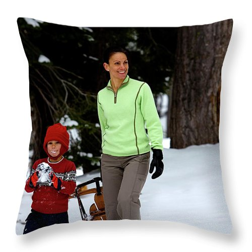 Action Throw Pillow featuring the photograph A Young Boy And Mother Sledding by Corey Rich