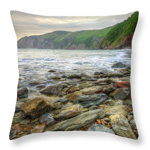Landscape Throw Pillow featuring the photograph Beautiful Warm Vibrant Sunrise Over Ocean With Cliffs And Rocks by Matthew Gibson