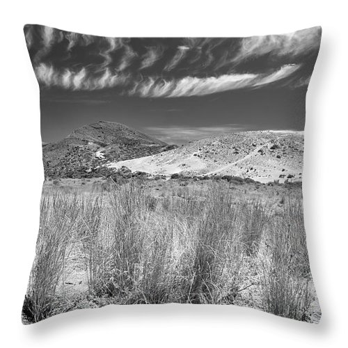 Black And White Throw Pillow featuring the photograph Capricious Clouds In The Volcanic Planet by Guido Montanes Castillo