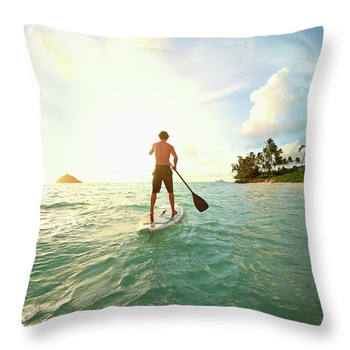 Tranquility Throw Pillow featuring the photograph Caucasian Man On Paddle Board In Ocean by Colin Anderson Productions Pty Ltd