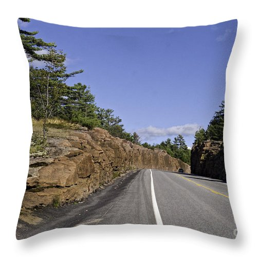 Rock Throw Pillow featuring the photograph Driving Through A Rock Cut by Les Palenik